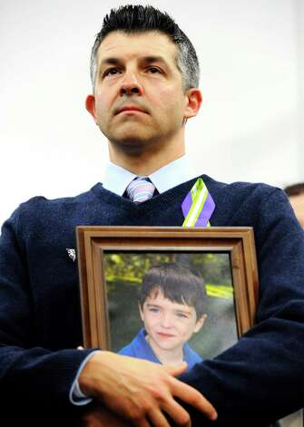 Ian Hockley, father of Sandy Hook School shooting victim Dylan, listens at a news conference at Edmond Town Hall in Newtown, Conn., Monday, Jan. 14, 2013. One month after the mass school shooting at Sandy Hook Elementary School, the parents joined a grassroots initiative called Sandy Hook Promise to support solutions for a safer community. Photo: Jessica Hill, Associated Press (AP Photo/Jessi / Associated Press