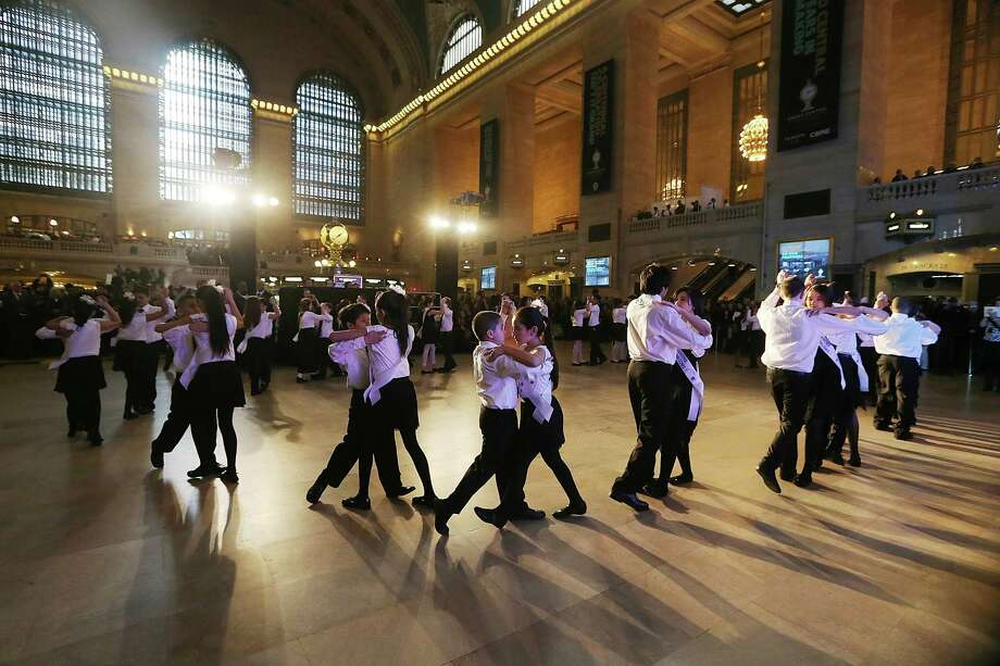 Young ballroom dancers from Dancing Classrooms dance in Grand Central Terminal during centennial celebrations. Photo: Mario Tama, Getty Images / 2013 Getty Images