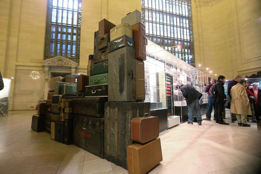 People look at a historic exhibition in Grand Central Terminal during centennial celebrations on the