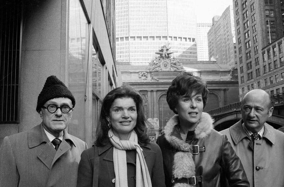 In Jan. 30, 1975 Jacqueline Kennedy Onassis, center left, and Bess Myerson, center right, walk with