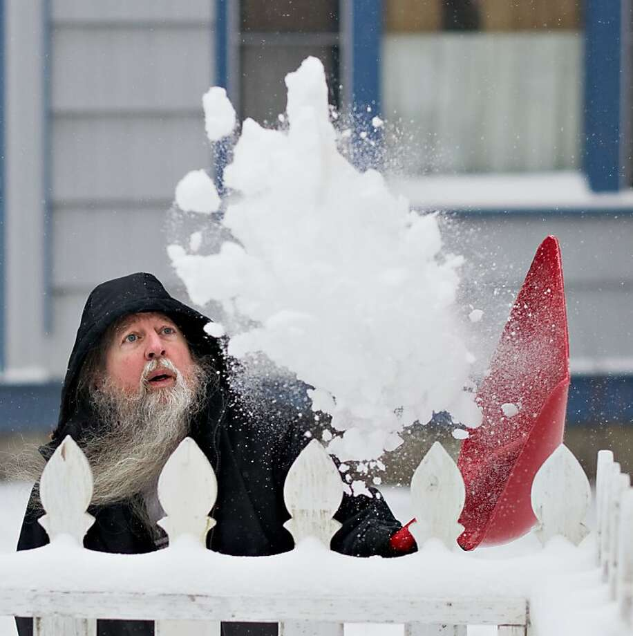 Be gone, frozen water crystals! Paul Erickson, church deacon and Gandalf look-alike, shovels snow in the yard of St. Nicholas Russian Orthodox Church in Juneau, Alaska. Photo: Michael Penn, Associated Press