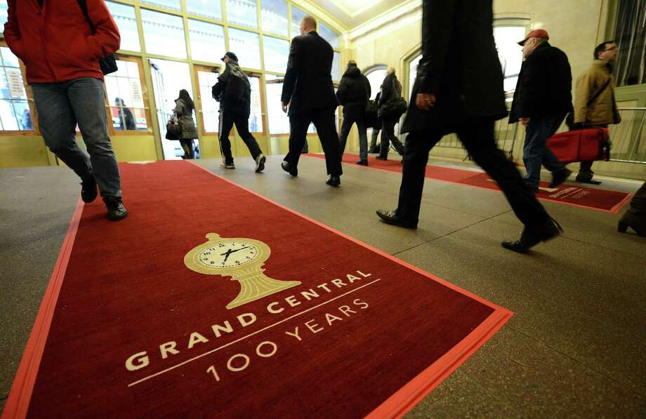 People make their way on a red carpet set up as part of the centennial celebrations for Grand Central Terminal in New York, February 1 , 2013 . Grand Central Terminal, the doyenne of US train stations, is celebrating its 100th birthday on February 2, 2013. Opened on February 2, 1913, when trains were a luxurious means of traveling across America, the New York landmark with its Beaux-Arts facade is still one of the US largest transportation hubs and is also New York's second-most-popular tourist attraction, after Times Square. Photo: EMMANUEL DUNAND, AFP/Getty Images / AFP