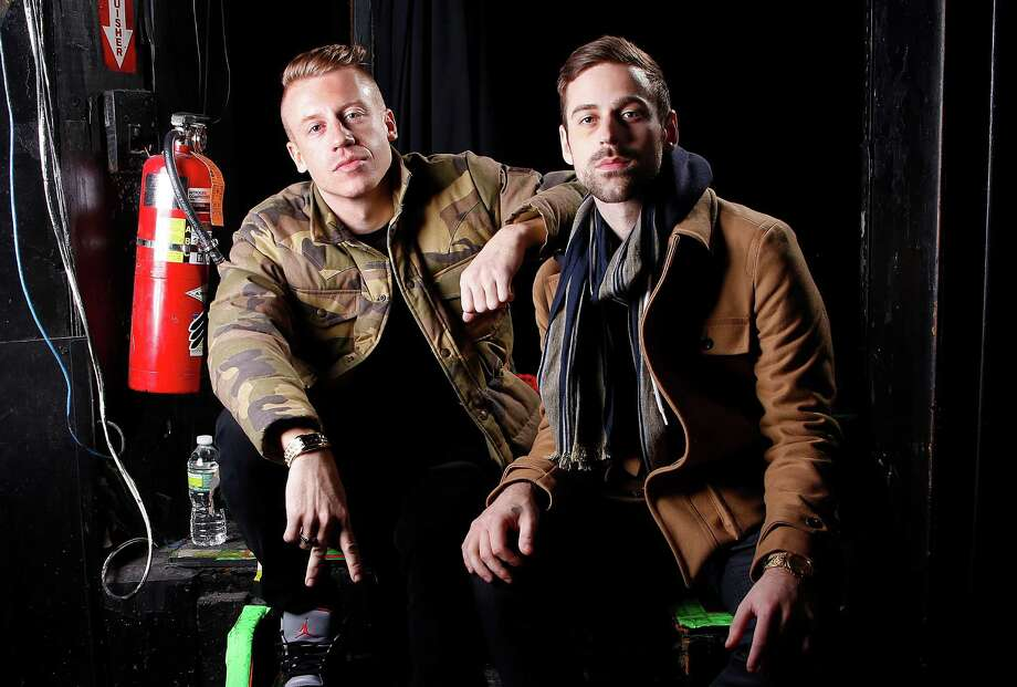 "FILE - This Nov. 20, 2012 file photo shows Ben Haggerty, better known by his stage name Macklemore, left, and his producer Ryan Lewis at Irving Plaza in New York. The rapper Macklemore thinks there's a simple reason his hit ""Thrift Shop"" appears to be going viral: It dares to be different. The Seattle-based duo has sold 2.3 million copies so far _ a million in the last month alone _ and sales continue to grow week to week. (Photo by Carlo Allegri/Invision/AP, file) Photo: Carlo Allegri"
