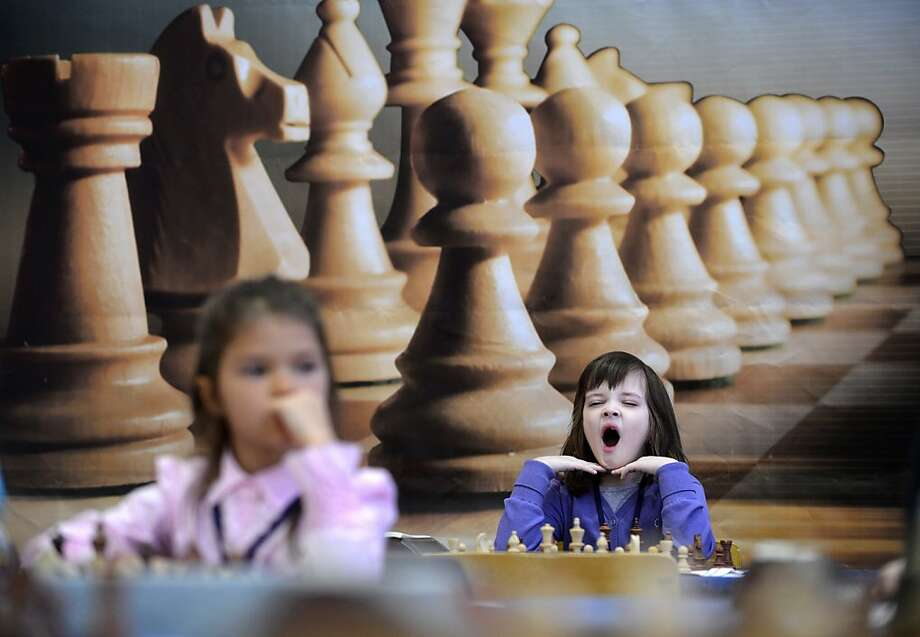 Little girls play chess as they take part in the Moscow Open 2013  Chess Festival  in Moscow on February 1, 2013. More than 700 players signed to participate in the 113,000 USD worth Chess Festival.  Photo: Natalia Kolesnikova, AFP/Getty Images