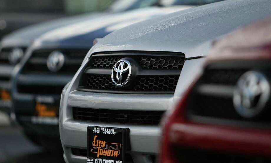 The Toyota logo is displayed on the grill of brand new Toyota RAV4s on the sales lot at City Toyota February 3, 2010 in Daly City, California. Toyota is being pressured by U.S. Transportation Secretary Ray LaHood who says the automaker isn't acting fast enough to fix millions of defective accelerator pedals on late model Toyota cars and trucks. LaHood retracted a statement today that Toyota owners should stop driving vehicles affected by the accelerator recall. Photo: Justin Sullivan, Getty Images / 2010 Getty Images