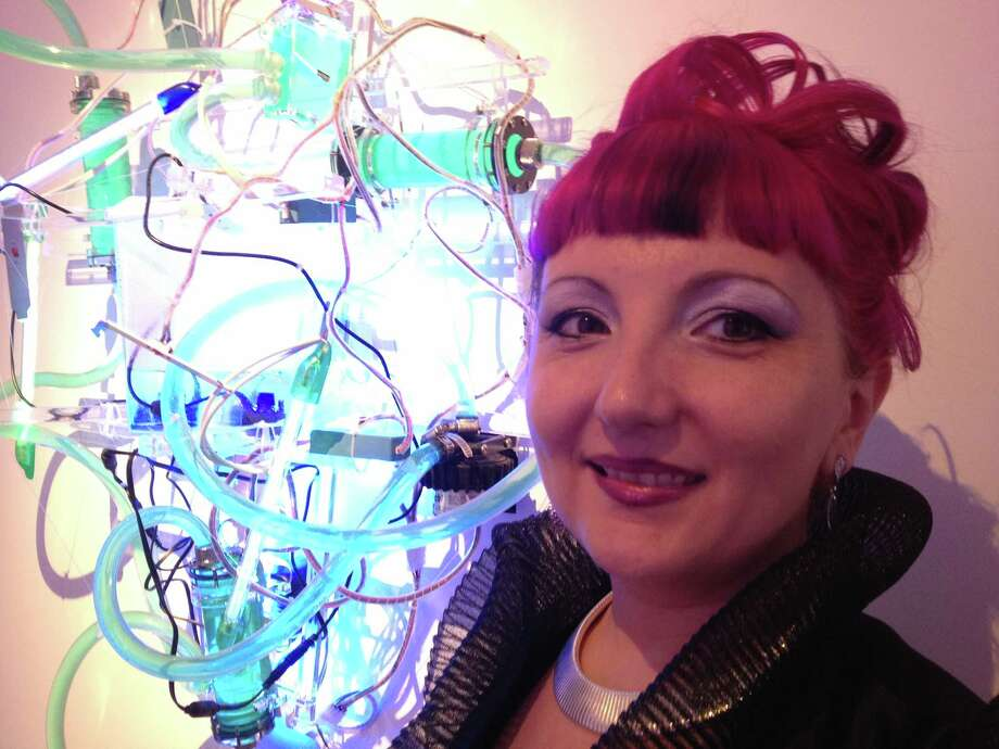 "Light sculptor Adela Andea created the hanging sculpture ""Techno-Alchemy Apparatus"" using a variety of neon tubes, LEDs, mirrors and other materials.  Photo: Molly Glentzer"