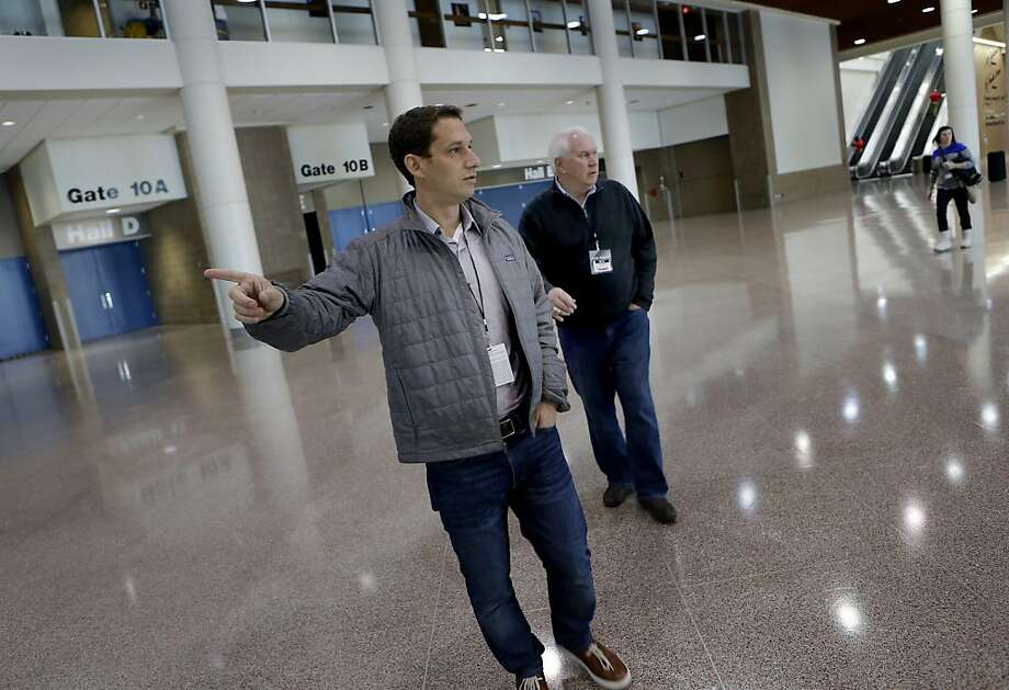 Daniel Lurie (left) and Pat Gallagher, advocates of a Bay Area Super Bowl, check out the cavernous New Orleans Ernest Morial Convention Center. Photo: Brant Ward, The Chronicle