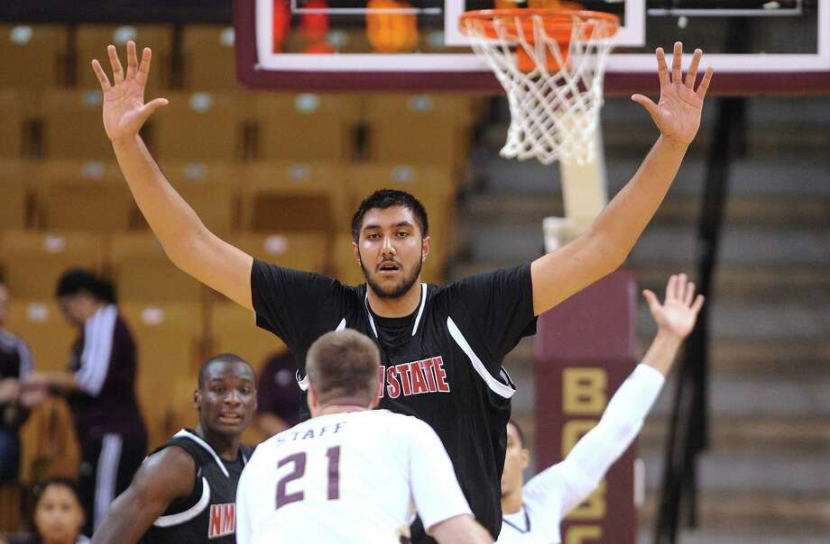 "New Mexico State center Sim Bhullar, who is 7'5"" tall, looks like a daunting obstacle for Matt Staff of Texas State during college basketball action in San Marcos on Thursday, Jan. 31, 2013. Photo: Billy Calzada, Express-News / San Antonio Express-News"
