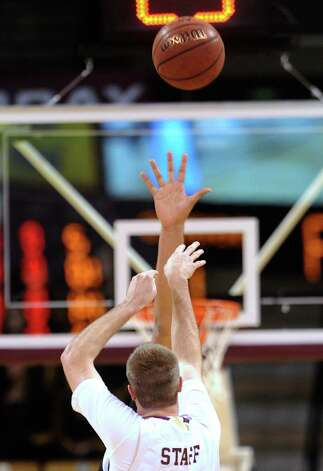 "Texas State's Matt Staff shoots over the outstretched hand of New Mexico State's 7'5"" center, Sim Bhullar, on Thursday, Jan. 31, 2013. Photo: Billy Calzada, Express-News / San Antonio Express-News"