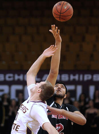 "New Mexico State center Sim Bhullar, who is 7'5"" tall, easily wins the tipoff against Matt Staff of Texas State on Thursday, Jan. 31, 2013. Photo: Billy Calzada, Express-News / San Antonio Express-News"