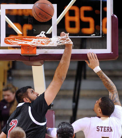 "New Mexico State center Sim Bhullar, left, defends as Corey Stern of Texas State shoots in San Marcos, Texas, on Thursday, Jan. 31, 2013. Bhullar is ais 7'5"" freshman. Photo: Billy Calzada, Express-News / San Antonio Express-News"