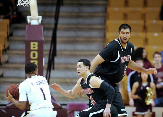 "New Mexico State center Sim Bhullar, who is 7'5"" tall, watches as teammate Terrel de Rouen guards Vonn Jones of Texas State on Thursday, Jan. 31, 2013. Photo: Billy Calzada, Express-News / San Antonio Express-News"