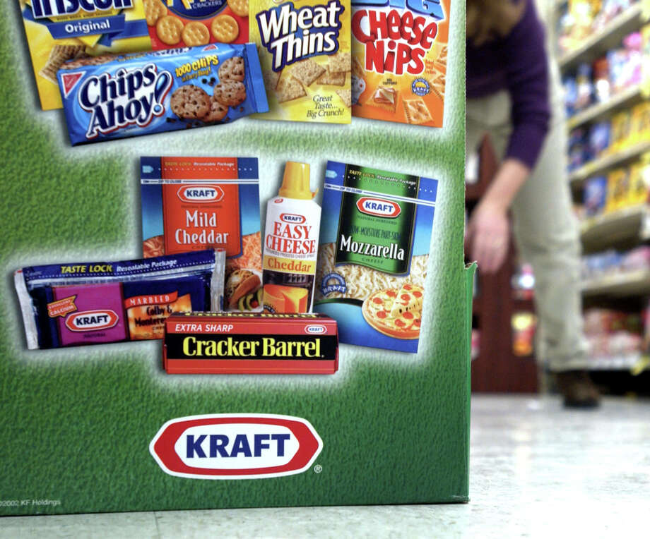 A display for Kraft products is seen in a grocery store in Wilmette, Illinois on January 29, 2003 as sales representative Misty Duensing, stocks the shelves behind. Shares of Kraft Foods Inc., whose products range from Velveeta cheese to Maxwell House Coffee, fell as much as 14 percent because profit this year will lag forecasts on higher benefits costs and weak Latin American economies. Photographer: Tannen Maury/Bloomberg News Photo: TANNEN MAURY, BLOOMBERG NEWS