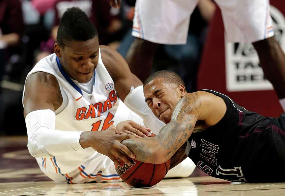 Florida's Will Yeguete (15) and Texas A&M's J'Mychal Reese (11) battle for a loose ball during the first half of an NCAA college basketball game on Thursday, Jan. 17, 2013, in College Station, Texas. (AP Photo/David J. Phillip) Photo: David J. Phillip, Associated Press / AP