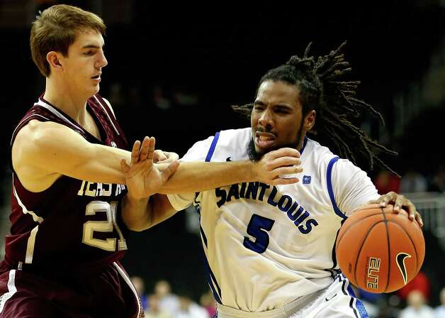 Jordair Jett (5) of Saint Louis drives as Alex Caruso (21) of Texas A&M during the CBE Hall of Fame Classic at Sprint Center on Nov. 19, 2012 in Kansas City, Missouri.  Jamie Squire/Getty Images Photo: Jamie Squire, Getty Images / 2012 Getty Images