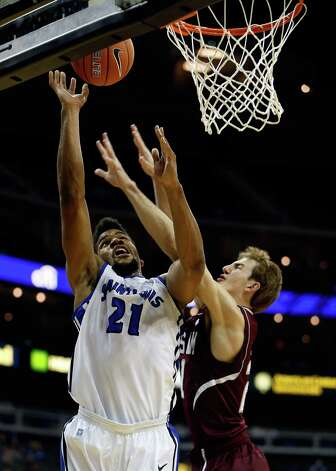 Dwayne Evans (21) of Saint Louis shoots over Alex Caruso (21) of Texas A&M during the CBE Hall of Fame Classic at Sprint Center on November 19, 2012 in Kansas City, Missouri.  Jamie Squire/Getty Images Photo: Jamie Squire, Getty Images / 2012 Getty Images