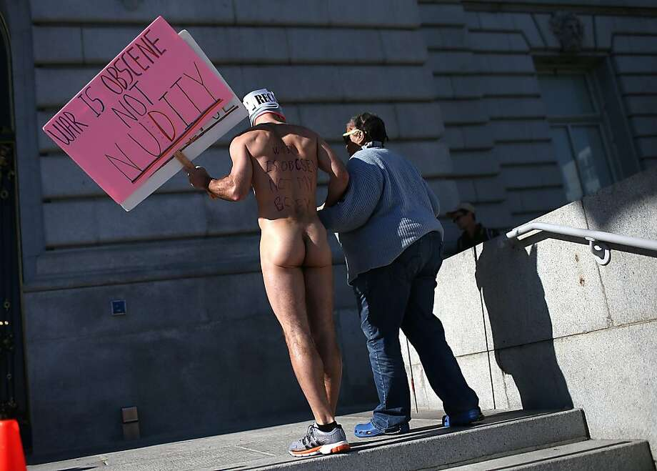 Nude activist Trey Allen helps a blind woman up stairs as he protests San Francisco's new ban on nudity at San Francisco City Hall on February 1, 2013 in San Francisco, California. At least four nude activists were arrested as they protested San Francisco's new ban on nudity in public places. The measure proposed by Supervisor Scott Wiener is being challenged by activists who call the ordinance unfair because it grants exceptions for nudity at permitted public events. Photo: Justin Sullivan, Getty Images