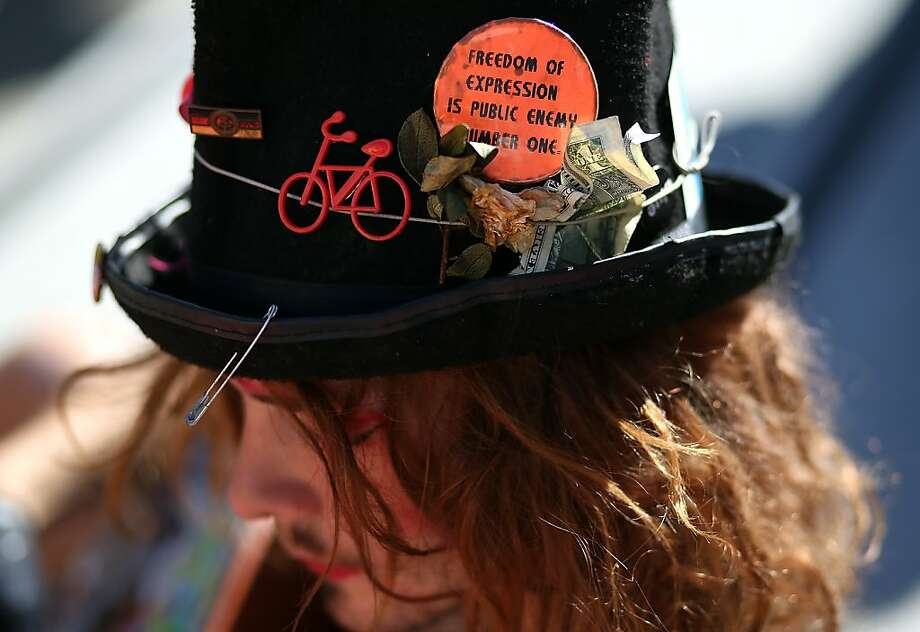 A nude activist wears a button on his hat as he protests San Francisco's new ban on nudity at San Francisco City Hall on February 1, 2013 in San Francisco. Photo: Justin Sullivan, Getty Images
