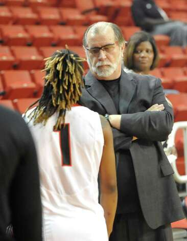 Head Coach Larry Tidwell, right, talks with Lady Cardinal #1 Gia Ayers, left, before the start of the game. The Lamar University Lady Cardinals tipped off at 5:30 p.m. against the Northwestern State Lady Demons Thursday night.  Dave Ryan/The Enterprise Photo: Dave Ryan