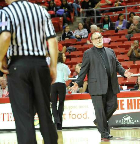 Head Coach Larry Tidwell, right, gestures to a referee as he leaves the court after the first half of the game.  The Lamar University Lady Cardinals tipped off at 5:30 p.m. against the Northwestern State Lady Demons Thursday night.  Dave Ryan/The Enterprise Photo: Dave Ryan