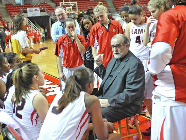Head Coach Larry Tidwell, center, talks with his Lady Cardinals during a timeout in the first half of the game. The Lamar University Lady Cardinals tipped off at 5:30 p.m. against the Northwestern State Lady Demons Thursday night.  Dave Ryan/The Enterprise Photo: Dave Ryan