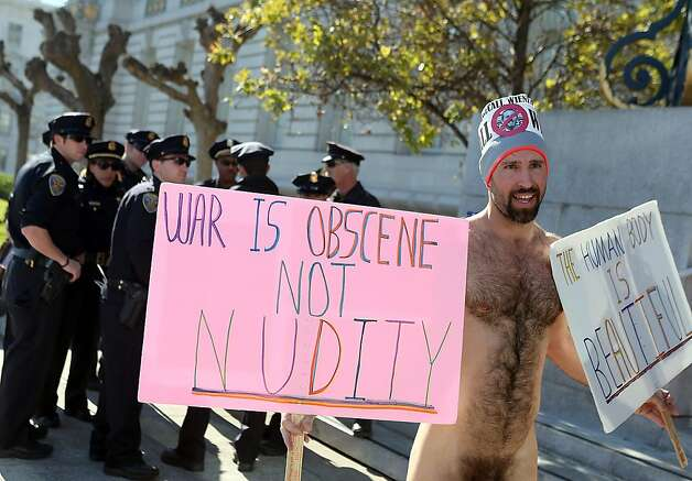 Nude activist Trey Allen stands nude in front of San Francisco police officers as  he protests San Francisco's new ban on nudity at San Francisco City Hall. Photo: Justin Sullivan, Getty Images