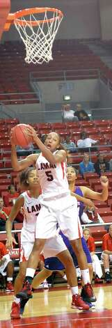 Lady Cardinal #5, Kalis Loyd, left, grabs a rebound from the Lady Demons during first half action. The Lamar University Lady Cardinals tipped off at 5:30 p.m. against the Northwestern State Lady Demons Thursday night.  Dave Ryan/The Enterprise Photo: Dave Ryan