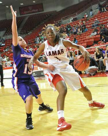 Lady Cardinal #1, Gia Ayers, right,, looks to get around Lady Demon #13, Janelle Perez, left, during first half action. The Lamar University Lady Cardinals tipped off at 5:30 p.m. against the Northwestern State Lady Demons Thursday night.  Dave Ryan/The Enterprise Photo: Dave Ryan