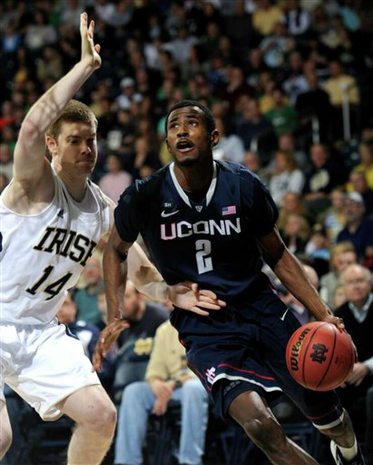 Connecticut forward DeAndre Daniels, right, drives the baseline as Notre Dame guard Scott Martin defends during the first half in an NCAA college basketball game, Saturday, Jan. 12, 2013, in South Bend, Ind. Photo: Joe Raymond, AP / FR25092 AP
