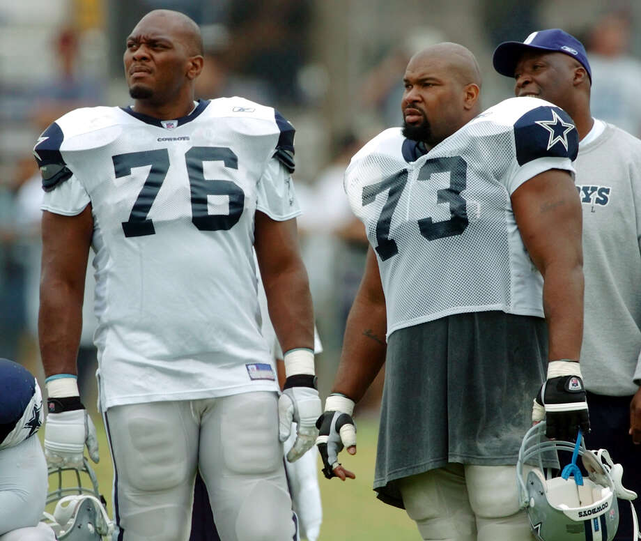Offensive linemen Flozell Adams (76) and Larry Allen (73) watch from the sideline as the kicking team practices during morning practice Thursday, August 5, 2004 in Oxnard, California. BAHRAM MARK SOBHANI/STAFF Photo: BAHRAM MARK SOBHANI, Express-News / SAN ANTONIO EXPRESS-NEWS