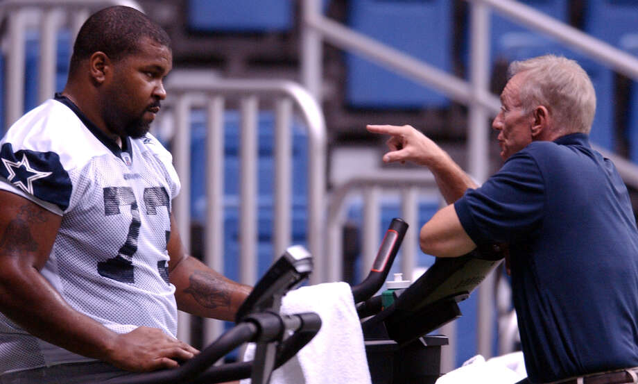 Cowboys' Larry Allen talks with owner Jerry Jones while working out on a staionary bike Monday Aug. 11, 2003 at the Alamodome. PHOTO BY EDWARD A. ORNELAS/STAFF Photo: EDWARD A. ORNELAS, Express-News / SAN ANTONIO EXPRESS-NEWS