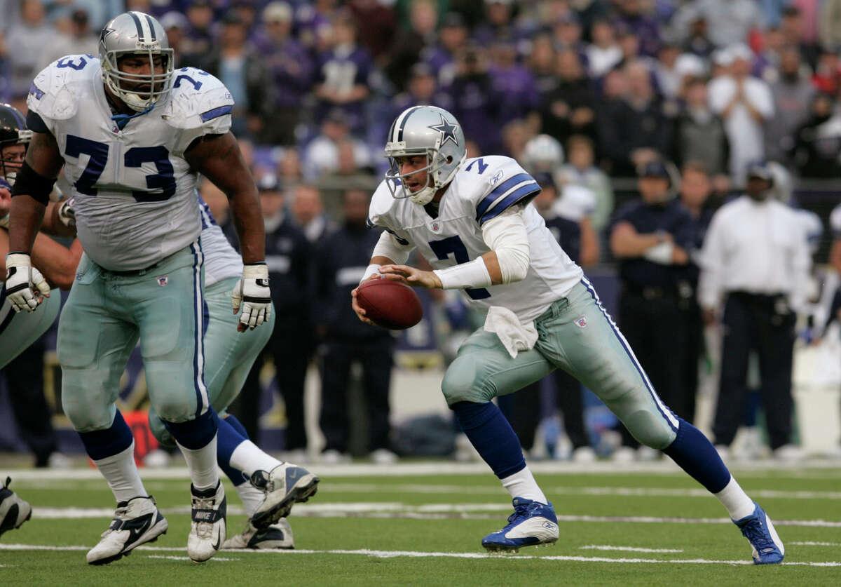 Dallas Cowboys quarterback Drew Henson, right, rushes past lineman Larry Allen, left, during the fourth quarter against the Baltimore Ravens Sunday, Nov. 21, 2004 in Baltimore.(AP Photo/Chris Gardner)