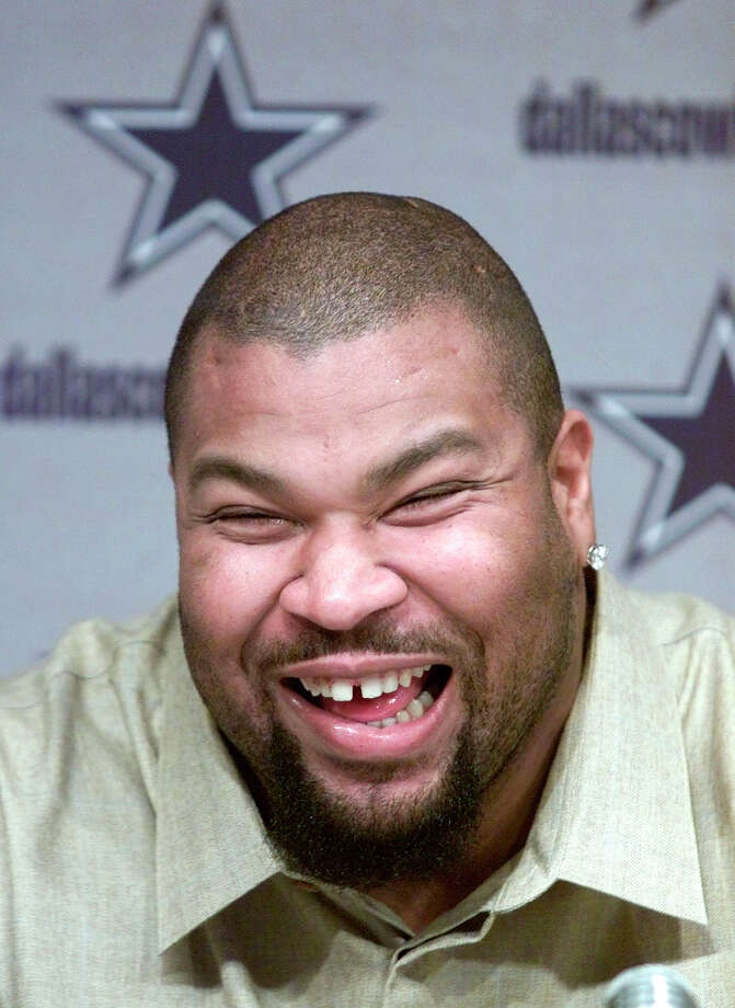 Dallas Cowboys guard Larry Allen laughs during a news conference in Irving, Texas, Thursday, March 7, 2002. The Cowboys announced a contract extension for All-Pro guard Allen.   (AP Photo/Donna McWilliam) Photo: DONNA MCWILLIAM, Associated Press / AP