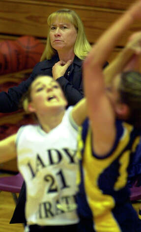 Poth's Head Coach Peggy Hosek watches the action between her Pirettes and the Center Point Lady Pirates at Paul Taylor Field House. Poth went on to win the game. PHOTO BY EDWARD A. ORNELAS/STAFF 2-14-00 Photo: EDWARD A. ORNELAS, Express-News / SAN ANTONIO EXPRESS-NEWS