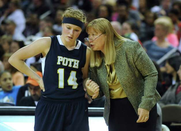 Poth basketball coach Peggy Hosek, gives junior guard Kelli Kolodziej direction during UIL Conference 2A state finals action in Austin on Saturday, March 3, 2012. Billy Calzada / San Antonio Express-News