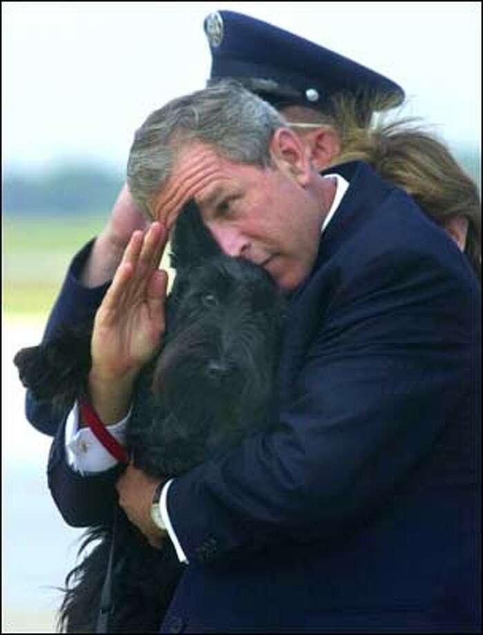 Barney making it difficult for President Bush to salute his Marine guards