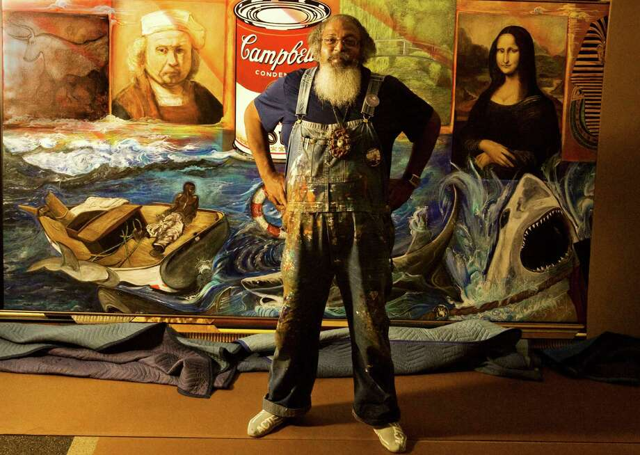 Local artist Bert Long as he unveils his mural at Looscan Library. Tuesday, Nov. 11, 2008, in Houston. (Billy Smith II / Chronicle ) Photo: Billy Smith II, Staff / Houston Chronicle