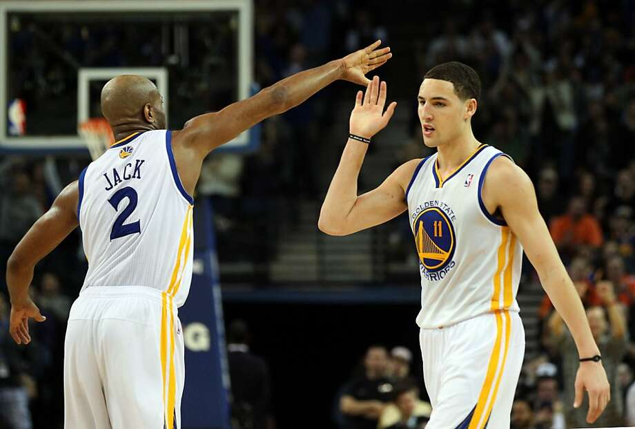 Klay Thompson (right) celebrates three of his 27 points Thursday against Dallas. Photo: Lance Iversen, The Chronicle