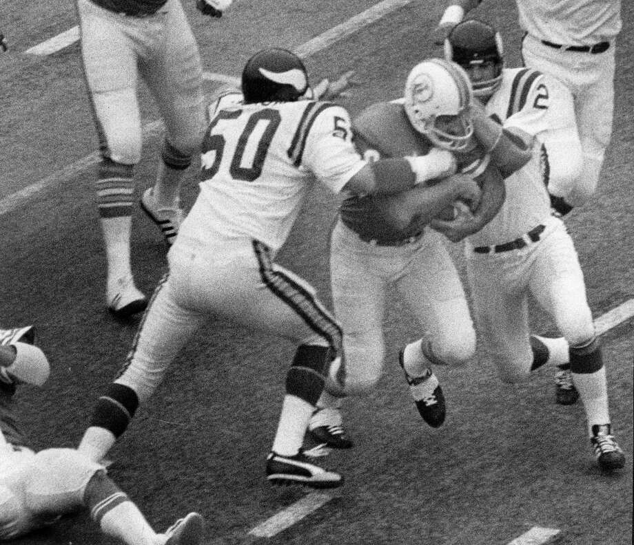 Miami Dolphins running back Larry Csonka goes in for touchdown while Vikings Jeff Siemon (50) and Paul Krause (22) tackle him. Photo: Curtis McGee, Houston Chronicle / Houston Chronicle