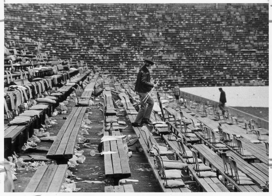 01/13/1974 - Rice Stadium strewn with trash and garbage after Super Bowl VIII between the Vikings and Dolphins.  HOUCHRON CAPTION (08/20/2000):  Super chore: Ushers wade through a sea of trash after Rice Stadium hosted Super Bowl VIII in 1974.  It cost an estimated $25,000 to clean up the stadium and parking lot after the game.     HOUCHRON CAPTION (01/25/2004):  Ushers wade through a sea of trash after Rice Stadium hosted Super Bowl VIII in 1974. It cost an estimated $25,000 to clean up the stadium and parking lot after the game.   SPECIAL SECTION:  SUPER BOWL XXXVIII 7 DAYS TO KICKOFF. Photo: CURTIS McGEE, Houston Chronicle / Houston Chronicle