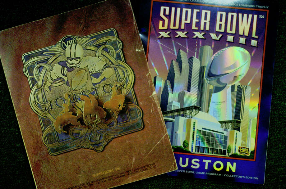The program from the first Houston Super Bowl (VIII) from 1974, left, and the current one (XXXVIII), right. Photo: Karen Warren, Houston Chronicle / Houston Chronicle