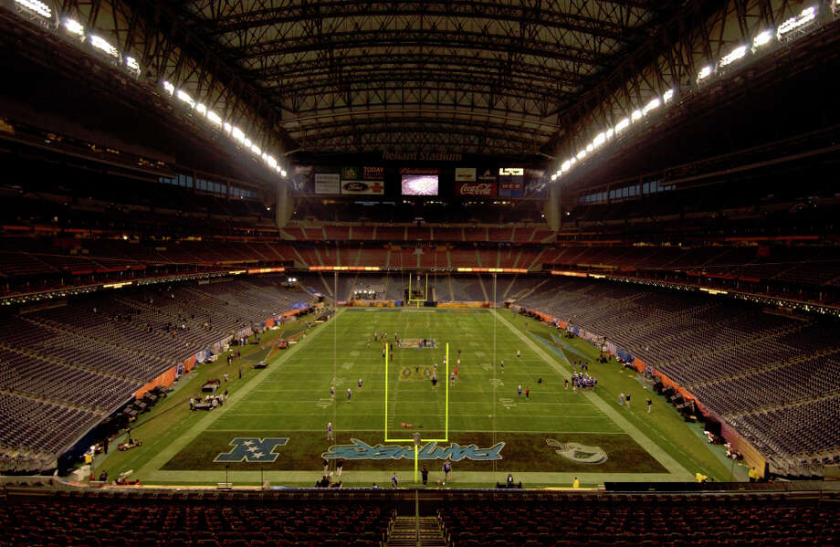 Reliant Stadium is almost ready to host the Superbowl on Sunday as the final lighting adjustments are made, the reheasals are over and the grounds crew is about to start the final treatments to the field. Photo: Karl Stolleis, Houston Chronicle / Houston Chronicle
