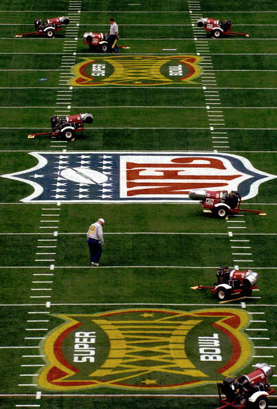 NFL grounds crew workers make the final adjustments to the field at Reliant Stadium Saturday in prep