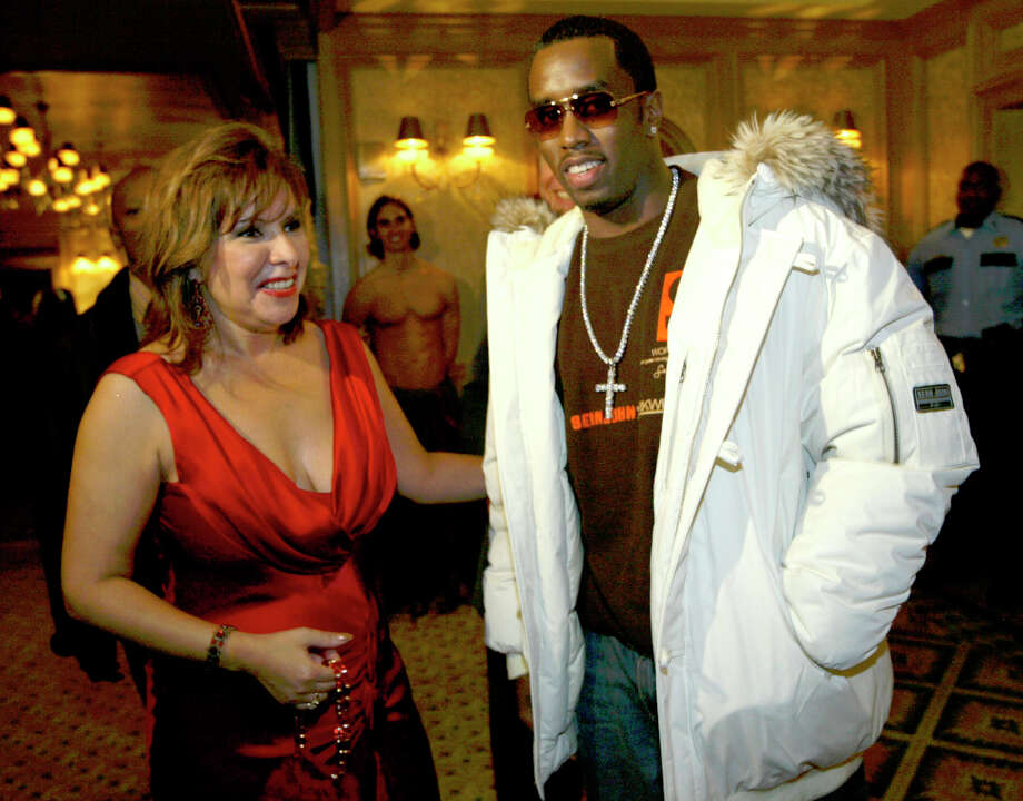 With the aid of Debbie Festari, P. Diddy makes his way through the crowd at the Super Celebrity Fashion Extravaganza held at the Aquarium restaurant. Photo: Andrew Innerarity, Houston Chronicle / Houston Chronicle