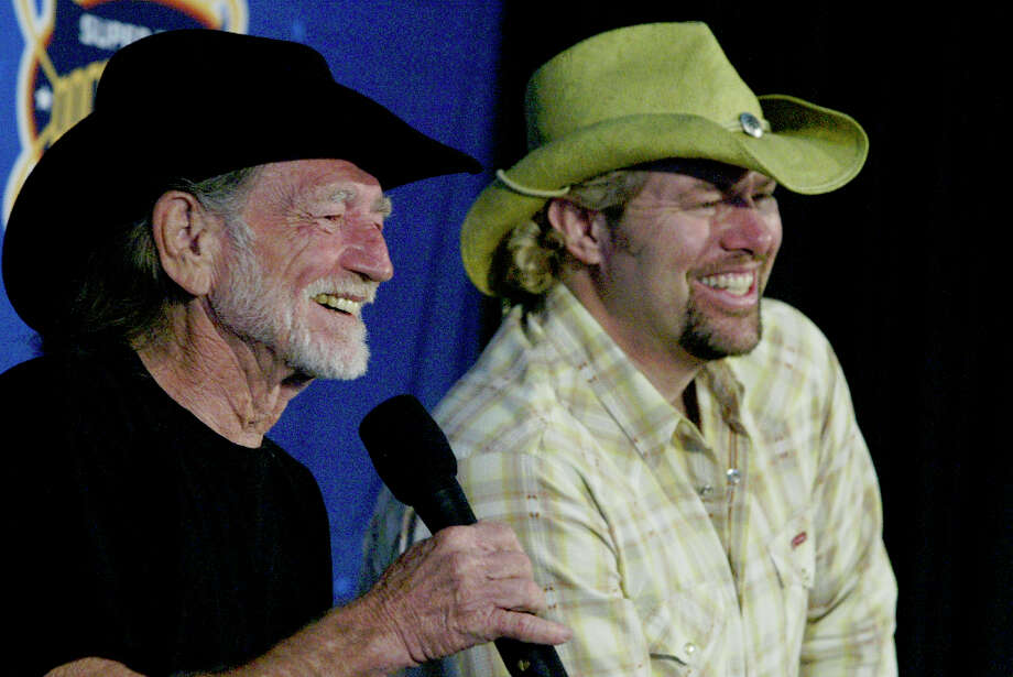 Willie Nelson, left, and Toby Keith share a laugh during a press conference on Jan. 30, 2004, at Reliant Center introducing the Pregame/Anthem entertainment for the Super Bowl. The two country-western stars will headline the pregame show along with Aerosmith, Walter Suhr and Mango Punch. Beyonce Knowles will sing the National Anthem. Photo: Buster Dean, Houston Chronicle / Houston Chronicle