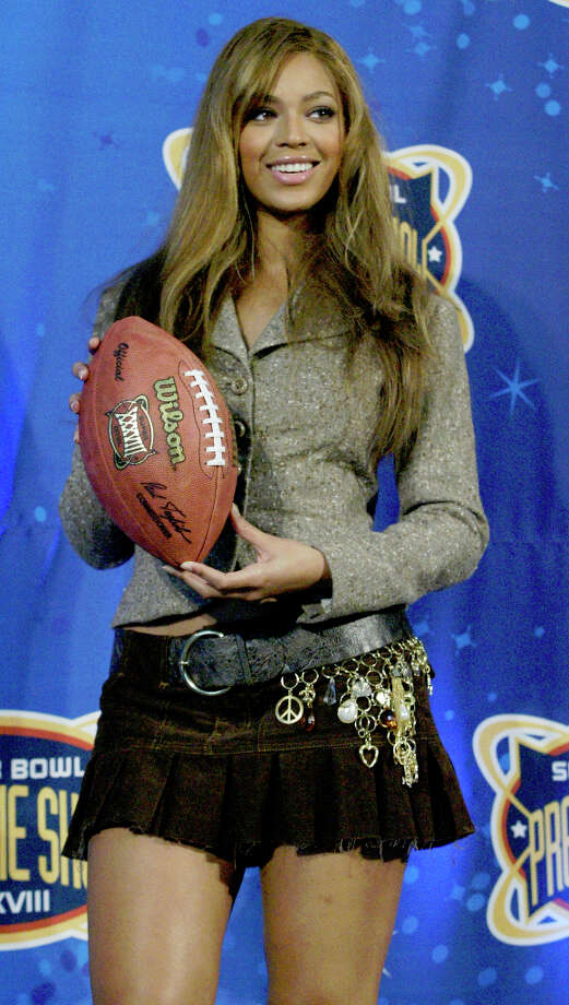 Beyonce Knowles poses during a press conference, 01/30/04, at Reliant Center introducing the Pregame/Anthem entertainment for the Super Bowl. Knowles will sing the National Anthem. Photo: Buster Dean, Houston Chronicle / Houston Chronicle
