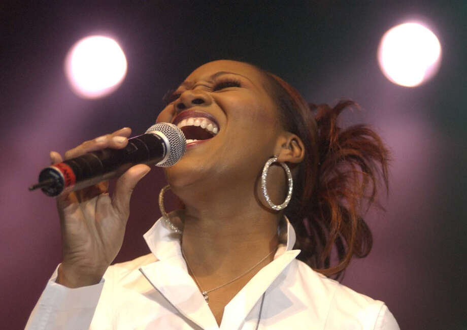 Houstonian Yolanda Adams performs during the Super Bowl Gospel Fest, at Reliant Arena, on Jan. 30, 2004. Photo: Ben DeSoto, Houston Chronicle / Houston Chronicle