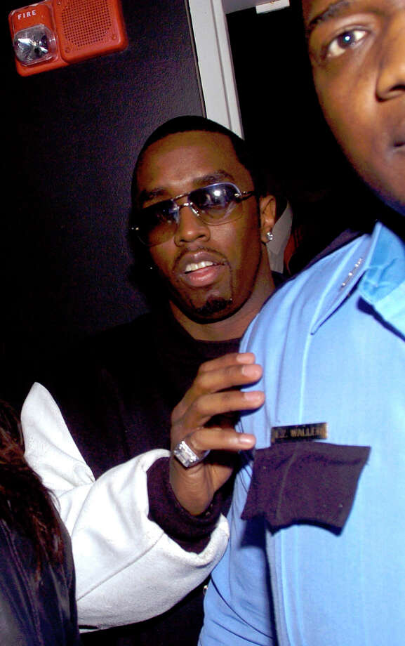 Sean 'P Diddy' Combs arrives at Hush for his Super Bowl party in the early hours of Saturday, Jan. 31, 2004, at Hush in Houston. Photo: BRETT COOMER, SPECIAL TO THE CHRONICLE / FREELANCE