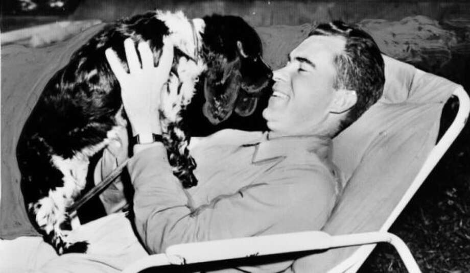 The famous portrait of then-Sen. Richard Nixon and Checkers, the adorable pup who may have saved his political career in 1952. While not officially a presidential dog, Checkers is as famous as any first dog.