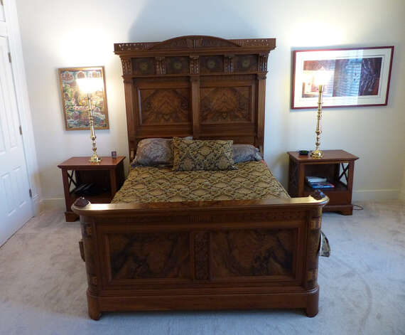 The bed in the master bedroom of the Pancoast home was made circa 1880 in the American Aesthetic Movement style. Wednesday, Jan. 30, 2013. Photo: Billy Calzada, San Antonio Express-News / SAN ANTONIO EXPRESS-NEWS